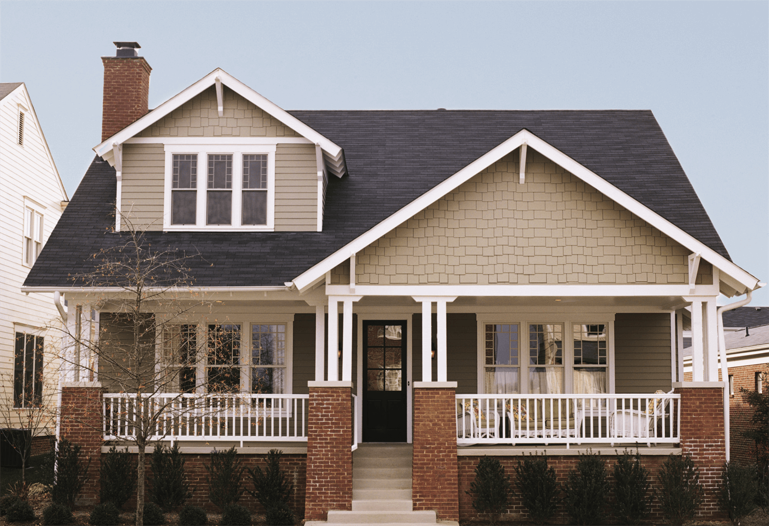 Brown House with Multiple Single Hung Windows